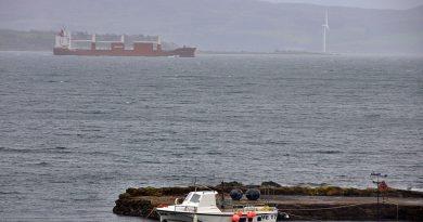 Ship passing Kilchattan Bay heading for Baltimore